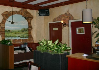 muurschildering trompe-l'oeil landschaprivier