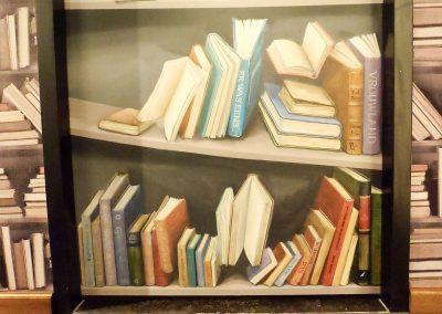 Muurschildering trompe l'oeil boekenkast